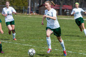 Megan Teeter dribbles the ball up the sideline for WMC. Photo/Randy Riksen