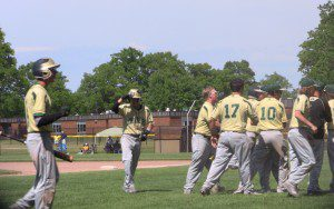 Muskegon Catholic reacts after Adam Callow scored the game-tying run in the bottom of the seventh.