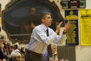 Coach Steve Hewitt coaches his Grand Haven Bucs team during last season rivalry game against Spring Lake. Photo/Jason Goorman