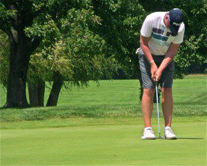 Kaleb Johnson putts during Sunday's action at the Henderson Memorial.