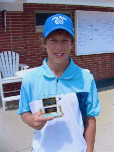 Garrett Norris shows off his trophy after winning the 14-under championship in a 20-hole playoff.