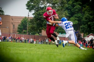 Muskegon's Shawn Pfenning breaks free from DCC's William Frush to put Muskegon on the board. Photo/Tim Reilly