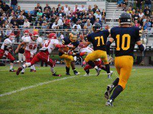 Venonell Smith gets ready to break through Holon's defense for a big touchdown run. Photo/Jason Goorman