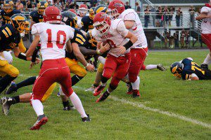 Holton's Hayden Cregg rushes for a nice gain against North Muskegon. Photo/Jason Goorman