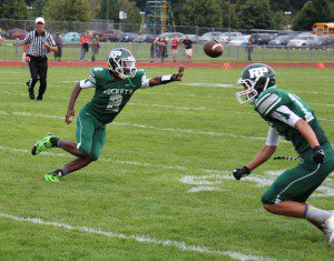 Reeths-Puffer quarterback Jalen Cooley pitches the ball during the Rockets' first scoring drive. Photo/Jason Goorman