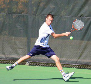 North Muskegon's Brock Dobb reaches the return in the back court during Saturday's singles final. Photo/Jason Goorman