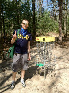 Local DG enthusiast Levi Fisher stands next to hole No. 6 after posting an ace at the Whitehall Township Disc Golf course.