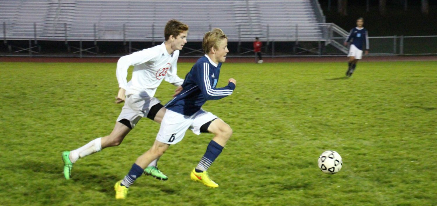 Mona Shores boys soccer clinches 3-1 win against Whitehall in rainy Monday night match-up [VIDEO]