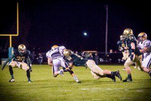 MCC's Nate jones sticks the tackle. Photo/Tim Reilly