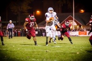 Mona Shores quarterback Tyree Jackson breaks free on the rush. Photo/Tim Reilly