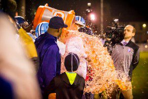 Mona Shores coach Matt Koziak gets doused with Gatorade just before his team celebrated their first conference championship since 1968. Photo/Tim Reilly