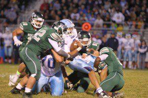 Mona Shores quarterback Tyree Jackson gets taken down by Reeths-Puffer. Photo/Joe Lane