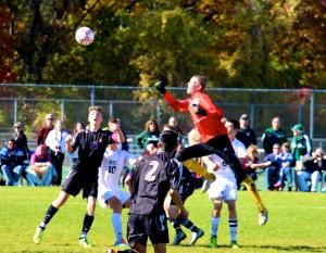 Michael Merze gets ready to punch the ball away. Photo/Jason Goorman