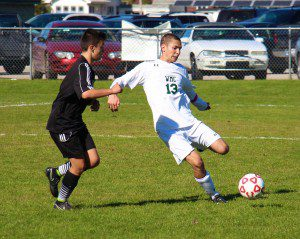 Eric Bourdo prepares to clear the ball during second half action for WMC. Photo/Jason Goorman