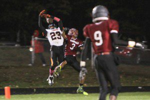 Tydrekus Purnell goes up for the pass as OV's Kris Wells tries to break up the play. Photo/Joe Lane