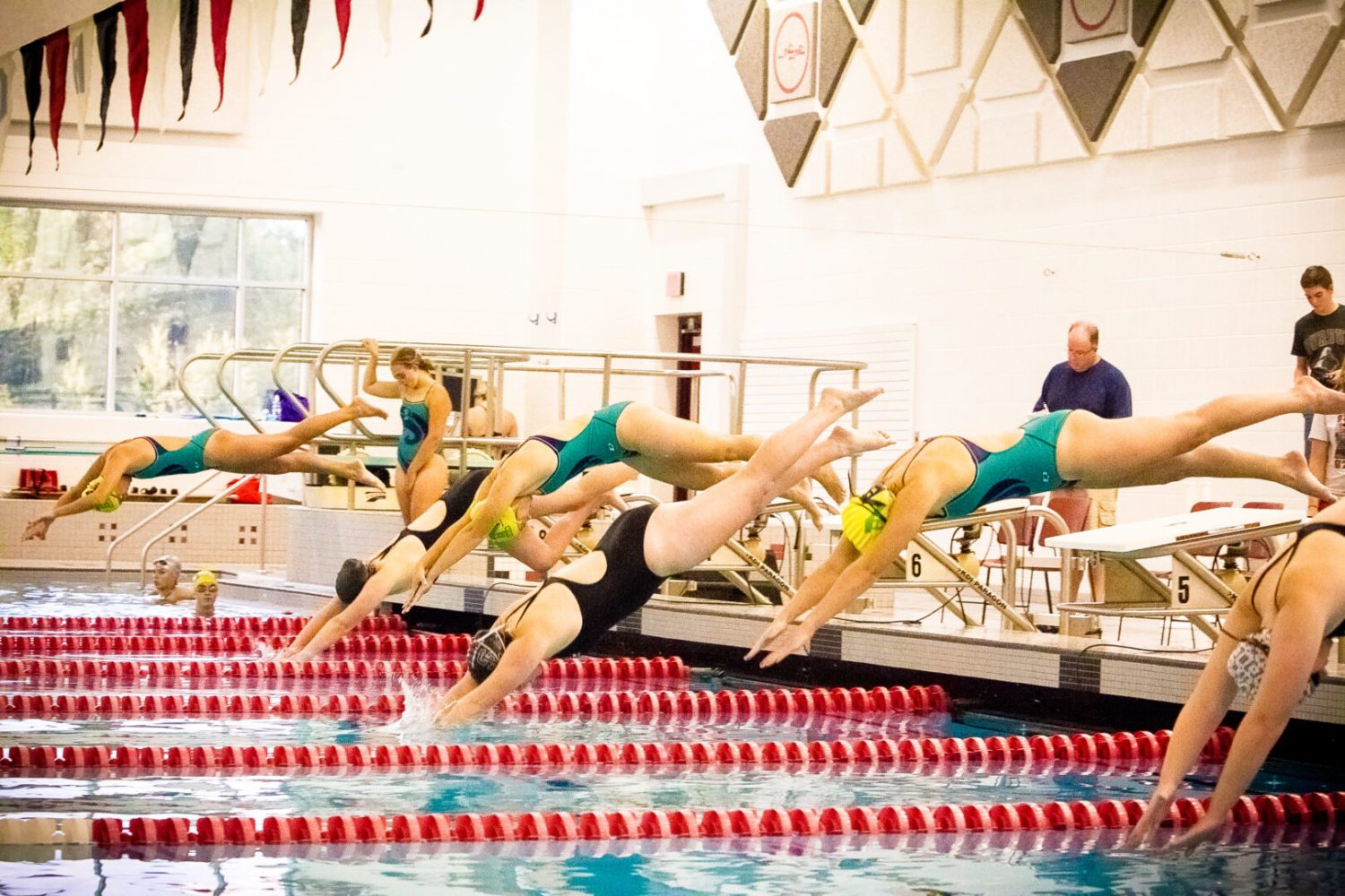 Muskegon Catholic/North Muskegon swim team is making big waves in the pool and in the classroom