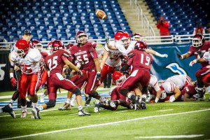 Muskegon #3 Alezay Coleman deals a punishing hit to cause the OLSM turnover at the goal line Photo/Tim Reilly