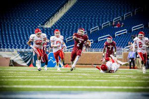Muskegon #2 Caleb Washington breaks free for the big gainer Photo/Tim Reilly