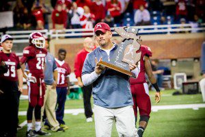 Muskegon Head Coach Shane Fairfield accepts the state runner-up trophy Photo/Tim Reilly