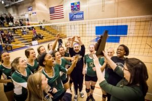 Muskegon Catholic celebrates after the Class D district championship win. Photo/Tim Reilly