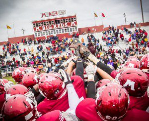 The Big Reds celebrate a district title. Photo/Tim Reilly