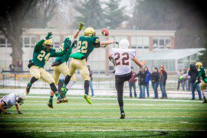 #22 Blake Sanford gets a piece of the punt to get MCC good field position(photo Tim Reilly)
