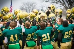 MCC raises their helmets in victory on their way to Ford Field(photo Tim Reilly)