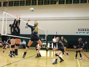 Ashly Schuitema goes for the quick set over the net for WMC. Photo/Jason Goorman