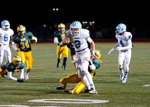 Tyree Jackson (3) scrambles to keep the chains moving for Mona Shores. Photo/Eric Sturr