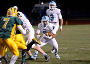 DeOntay Moffett finds the open hole on his way to having a huge night carrying the ball for Mona Shores.