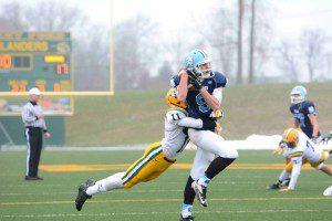 Matt Schuiteman (9) catches a big pass over the middle inside the Farmington Hills ten yard line.