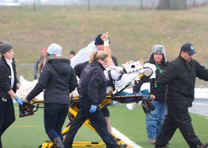 Backup quarterback Tyler Trovinger gives the thumbs up as he's carted off the field. Photo/Eric Sturr