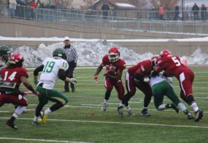 Alzuan Evens rushes the ball up the middle for Muskegon. Photo/Jason Goorman