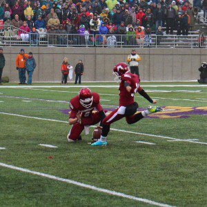 Miguel Flores kicks a new Muskegon record field goal from 53 yard out as time expires. Photo/Jason Goorman