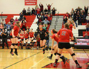 Whitehall celebrates after dropping in match point. Photo/Jason Goorman