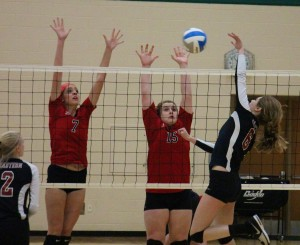 Whitehall's No. 7 Rachel Brown and Brianna Copley go for a block. Photo/Jason Goorman