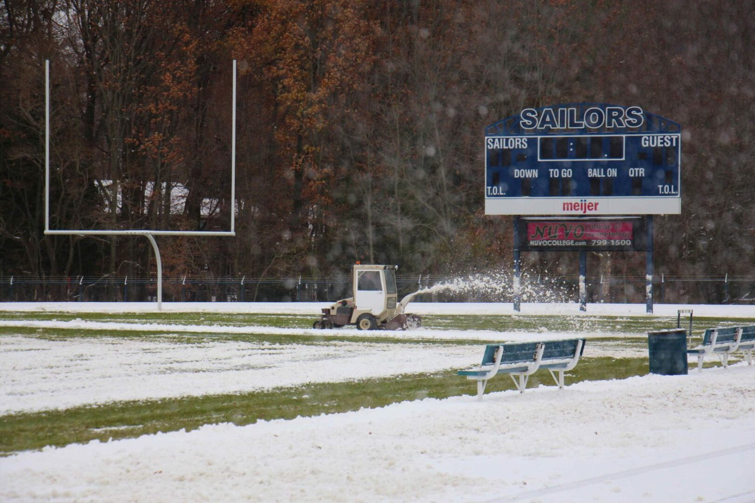 Mona Shores parents show up with shovels, snowblowers to help clear the stadium for tonight's playoff game