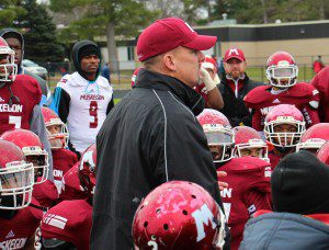 Muskegon Big Red Coach Shane Fairfield talks to his team after they topped Petosky for the regional championship. Photo/Jason Goorman