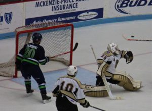 Eric Schierhorn posts the save in the third period for Muskegon. Photo/Jason Goorman