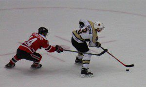Joseph Cecconi brings the puck towards the net against Waterloo on Nov. 21. Photo/Jason Goorman