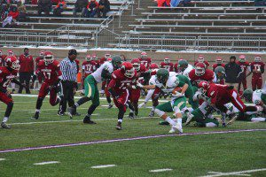 Muskegon's Taran Smith looks to take down Zeeland West running back Dakota Geurink. Photo/Jason Goorman