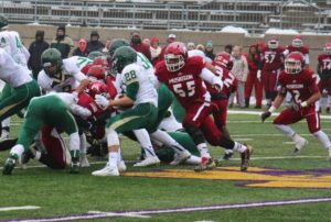 Muskegon's No. 55 Rowland Sharp II gets ready to hit Zeeland West's Dakota Geurink on the rush. Photo/Jason Goorman