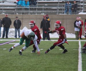 Muskegon's Taran Smith continues to give Zeeland West a hard time in the backfield. Photo/Jason Goorman