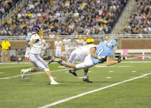 Matt Schuiteman (9) is tackled after a pass completion over the middle.