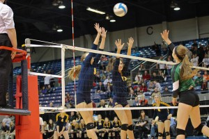Grand Haven No. 9 Amy Kober and No. 13 Ally Knoll go for the block. Photo/Sally Ross