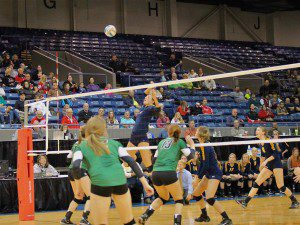 Grand Haven s Emily Lachmann goes for the spike. Photo/Sally Ross