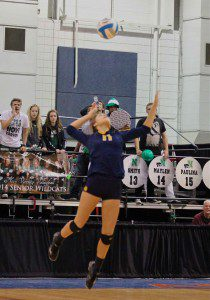 Libby Cole on the serve for Grand Haven. Photo/Sally Ross