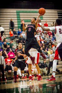 Big Reds #3 Linwood Lee drives to the hoop photo/Tim Reilly