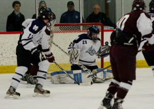 Mona Shores' Timothy McClain (29) makes a second period save on U of D Jesuit. Photo/Eric Sturr