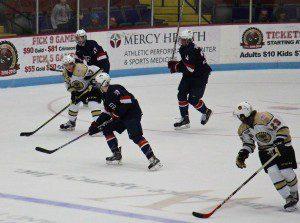 No. 17 David Keefer looks up ice for Keegan Ward. Photo/Jason Goorman